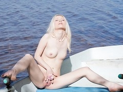 What can a beautiful golden-haired do all alone in a boat in the middle of a lake? Find out in this steamy schemes porn clip!